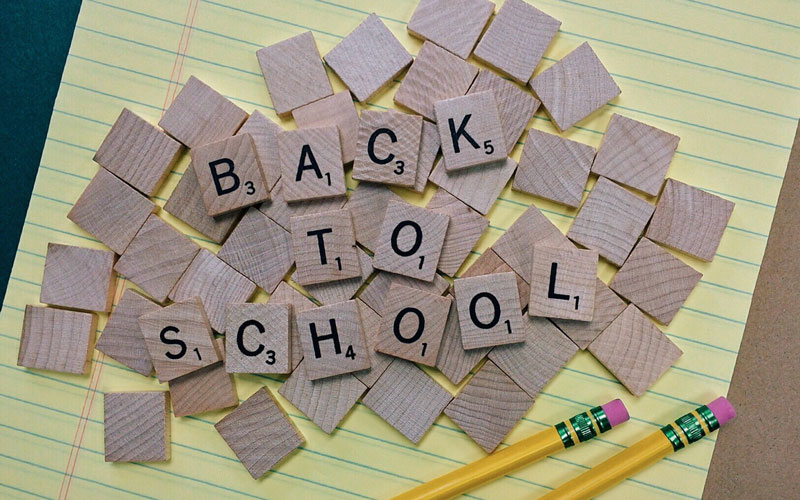 Back to School - Scrabble tiles spelling out back to school with pencil